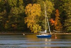 Sailboat in fall. Sailboat at anchor in fall Stock Photography