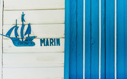 Sailboat or fishing boat made of wood as nautical decoration on wooden background. On the front of a wooden sailing hut Royalty Free Stock Image