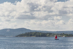 Sailboat in fjord 4. Sailboat in Oslo fjord with nature in the background Stock Images