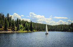 Sailboat floating along the lake Stock Photo
