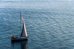 Sailboat floating on the sea surface Royalty Free Stock Images
