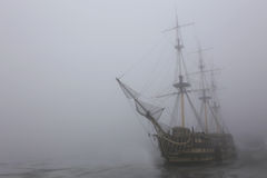 Sailboat in the fog. Old ship in the fog of the winter Parking Royalty Free Stock Photography