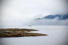 Sailboat in the fog Royalty Free Stock Photos
