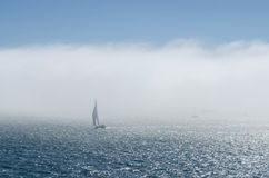 Sailboat and fog. Silhouette of sailboat in the fog in Sausalito, California Royalty Free Stock Photos