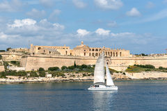 Sailboat on front of Valletta Stock Photos