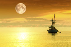 Sailboat and full moon Stock Image