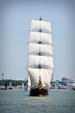Sailboat on full sails. Sailboat going out of port with full sails up Royalty Free Stock Photo