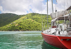 Sailboat getaway. Beautiful large and luxurious sailboat anchored next to a tropical island Stock Photo
