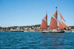 Sailing on the Penobscot Bay. A sailboat glides over the calm waters of the Penobscot Bay on a summer day Royalty Free Stock Image