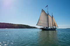 Sailing on the Penobscot Bay. A sailboat glides over the calm waters of the Penobscot Bay on a summer day Stock Photography