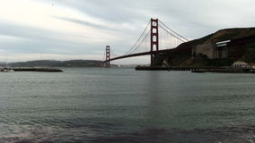 Sailboat Going Under Golden Gate Bridge San Francisco Bay. View Of Golden Gate Bridge From Marin Side With Sailboat stock video