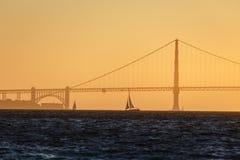 Sailboat and Golden Gate Bridge Stock Photo