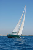 Sailboat. Green Sailboat near the coast Royalty Free Stock Images