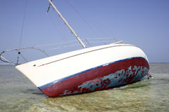 Sailboat grounded Royalty Free Stock Image