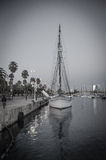 Sailboat in harbor Stock Images