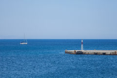 Sailboat and harbor fragment in Rhodes, Greece island. Royalty Free Stock Photo