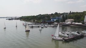 Sailboat harbor, many beautiful moored sail yachts in the sea port, modern water transport, summertime vacation stock video