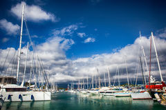 Sailboat harbor, many moored sail yachts in the sea port Stock Photography
