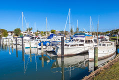 Sailboat harbor and many moored sail yachts in the sea port. Royalty Free Stock Photography