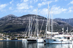 Sailboat harbor. Many moored sail yachts in the sea port. Stock Photo
