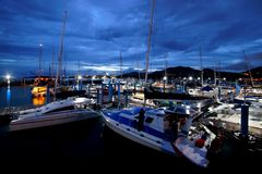 Sailboat harbor, moored sail yachts in the sea port. At twilight time Stock Images