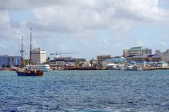 Sailboat at Grand Caymen. Sailboat in the harbor, off the coast of Grand Cayman in the Cayman Islands, with the pier and cruise ship tenders in the background Royalty Free Stock Photography