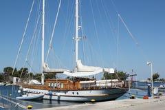 Sailboat in harbor summer scene Stock Image