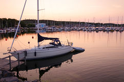 Sailboat harbor at sunset Stock Photo