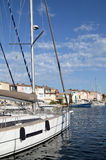 Sailboat in harbour Royalty Free Stock Photography
