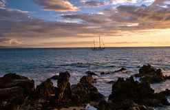 Sailboat and Hawaiian sunset on island of Maui Royalty Free Stock Photos