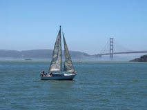 Sailboat Heading for SF Bay Bridge Stock Photography