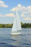 Sailboat heading to sea Stock Photo