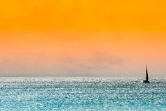 Sailboat in a high contrast and hazy seascape Royalty Free Stock Images