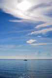 Sailboat on the horizon Stock Images