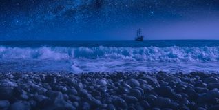 Sailboat on a horizon at night stock images