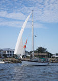 Sailboat on the ICW. Going for a sail on a beautiful fall afternoon, this sailboat catches a nice breeze Royalty Free Stock Photos
