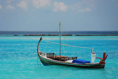Sailboat in Indian ocean. Traditional sailboat in blue Indian ocean by Maldives Stock Photography