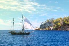 Sailboat and island Royalty Free Stock Image