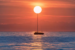 Sailboat just before the sunset. Royalty Free Stock Photo