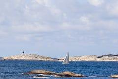 Sailboat and kayak Stock Photos