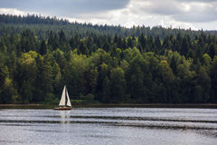 Sailboat on lake. Stock Photo
