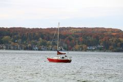 Sailboat in lake during fall in Chalevoix. Sailboat in lake Charlevoix Michigan during fall 2017 Royalty Free Stock Images