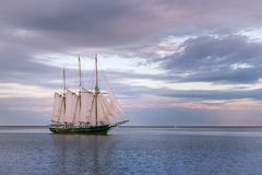 Sailboat on Lake Michigan in Milwaukee, Wisconsin. At sunrise with beautiful cloudy skies stock photos