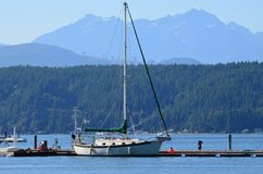 Sailboat on a lake Royalty Free Stock Photos
