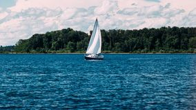 Sailboat on lake. White sailboat. Sailing on lake Stock Images