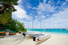 Sailboat laying on the beach Royalty Free Stock Images