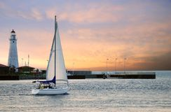 Sailboat leaving marina Royalty Free Stock Photo