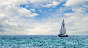 Sailboat on light blue water off Florida Gulf Royalty Free Stock Photo