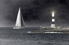 The sailboat and the lighthouse Royalty Free Stock Image