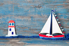 Sailboat and lighthouse decoration Stock Photo